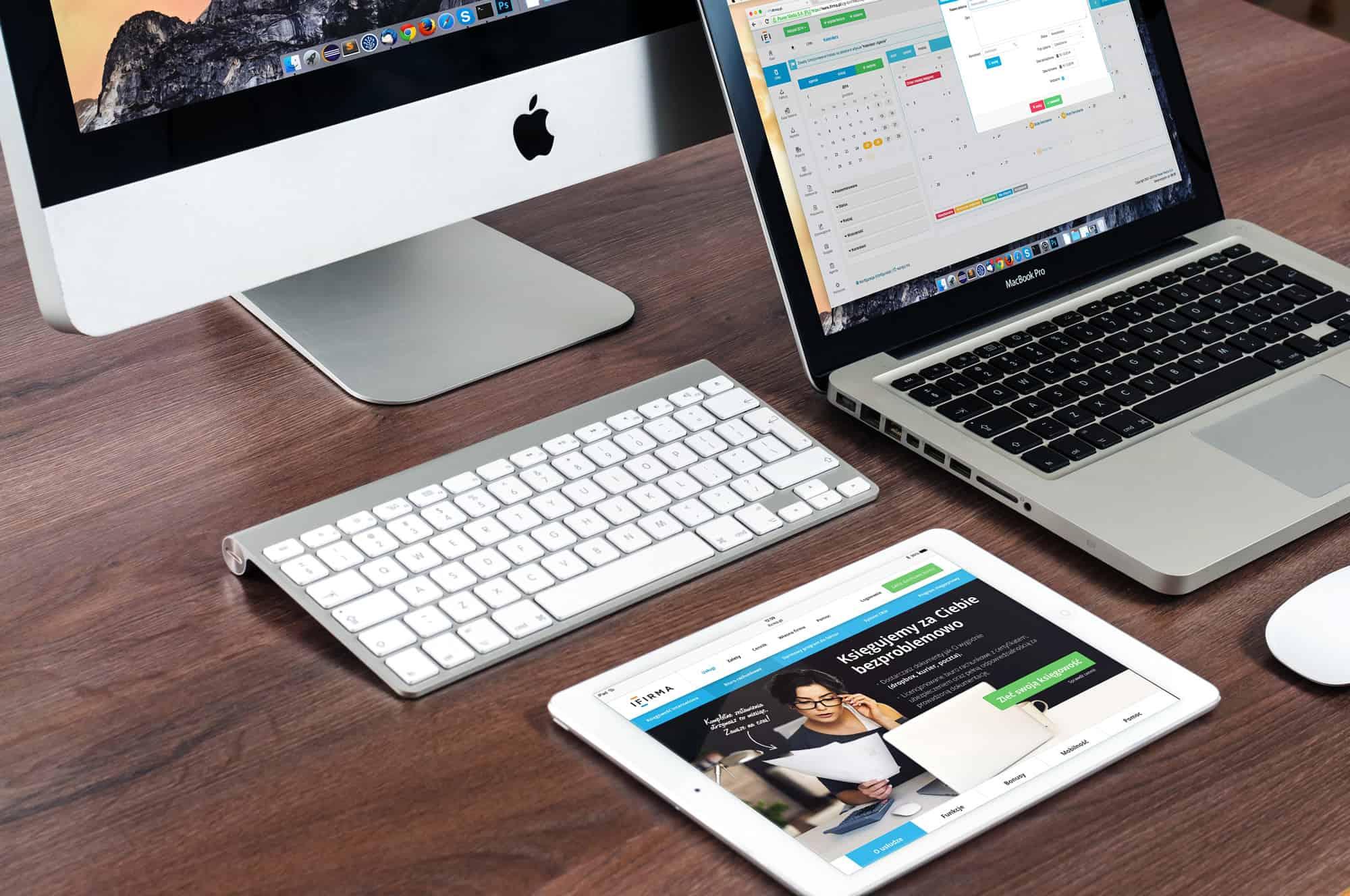 Image | desk with laptop, tablet and desktop computer